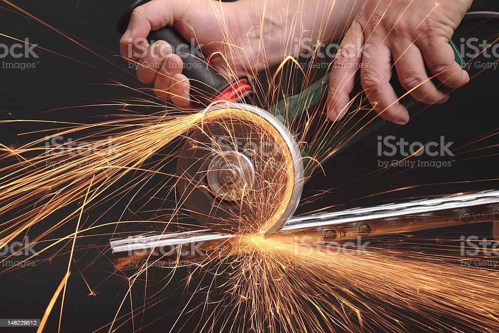 Angle grinder in action, black background royalty-free stock photo