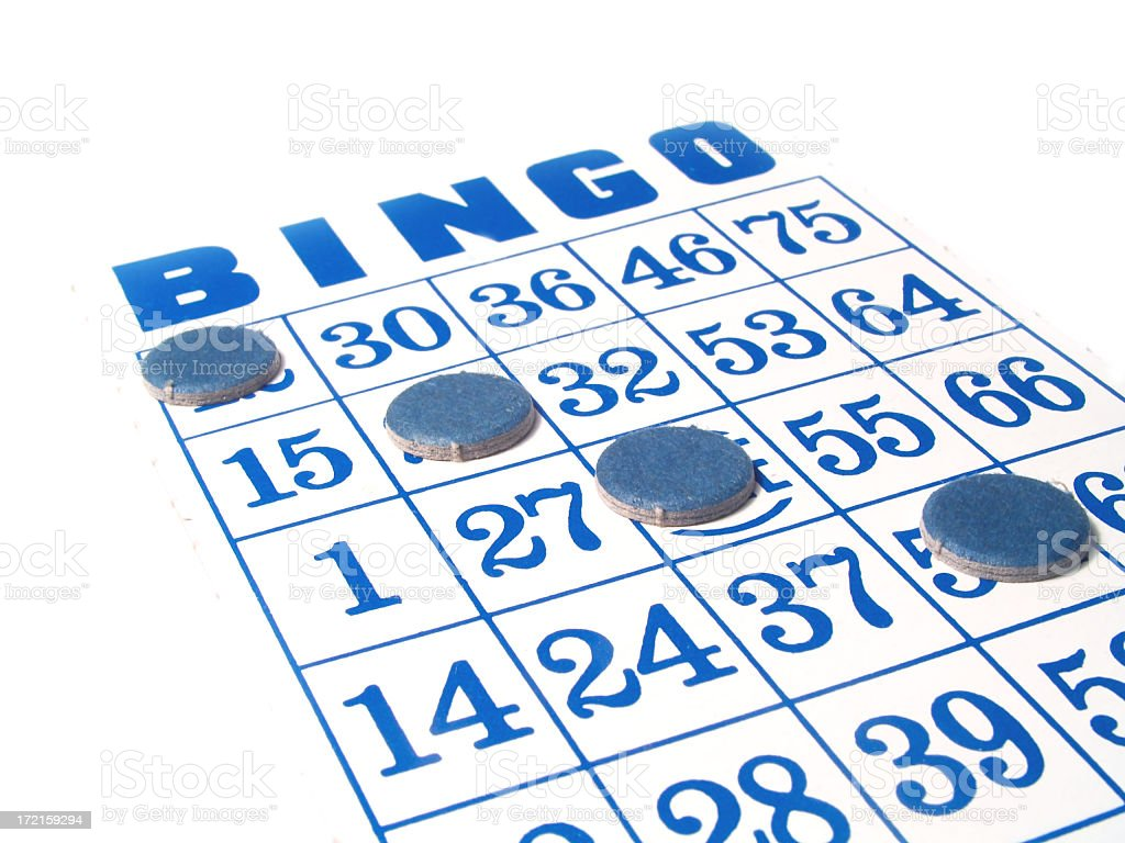 Angle view of a Bingo sheet with markers going diagonally stock photo