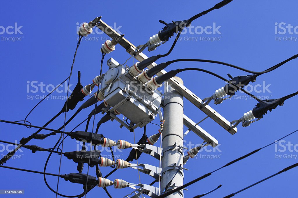 Angle view of electricity pylon on blue sky royalty-free stock photo