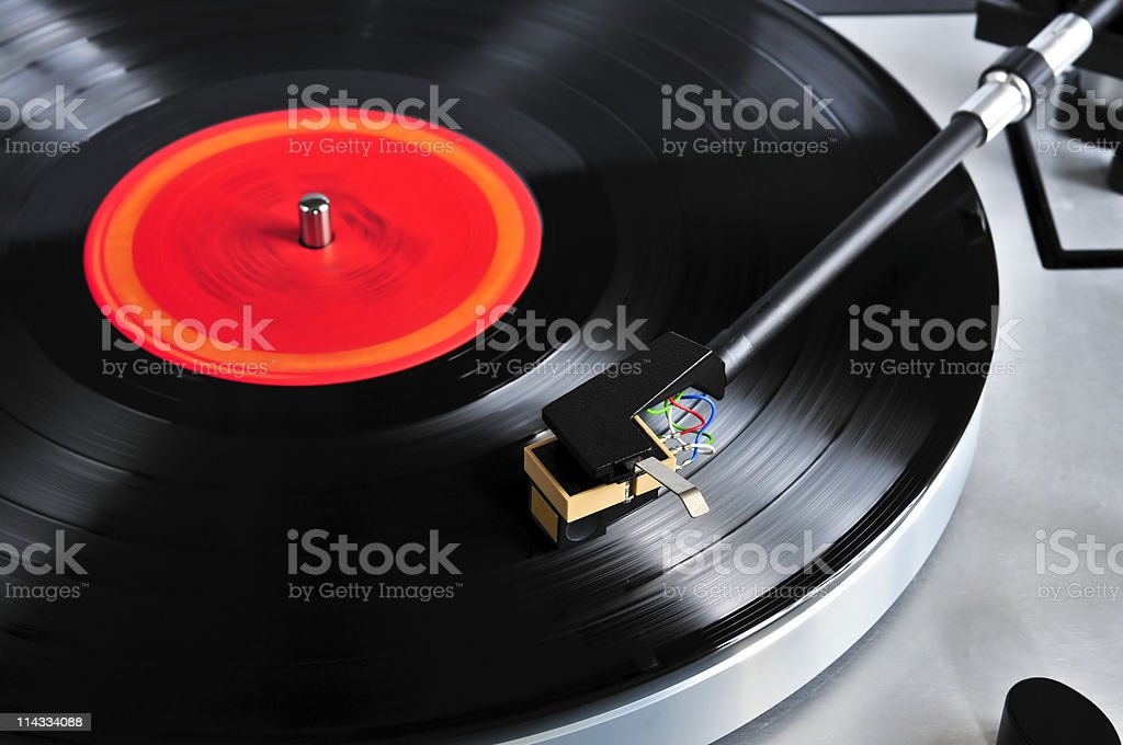 Angled close-up of record on a turntable stock photo