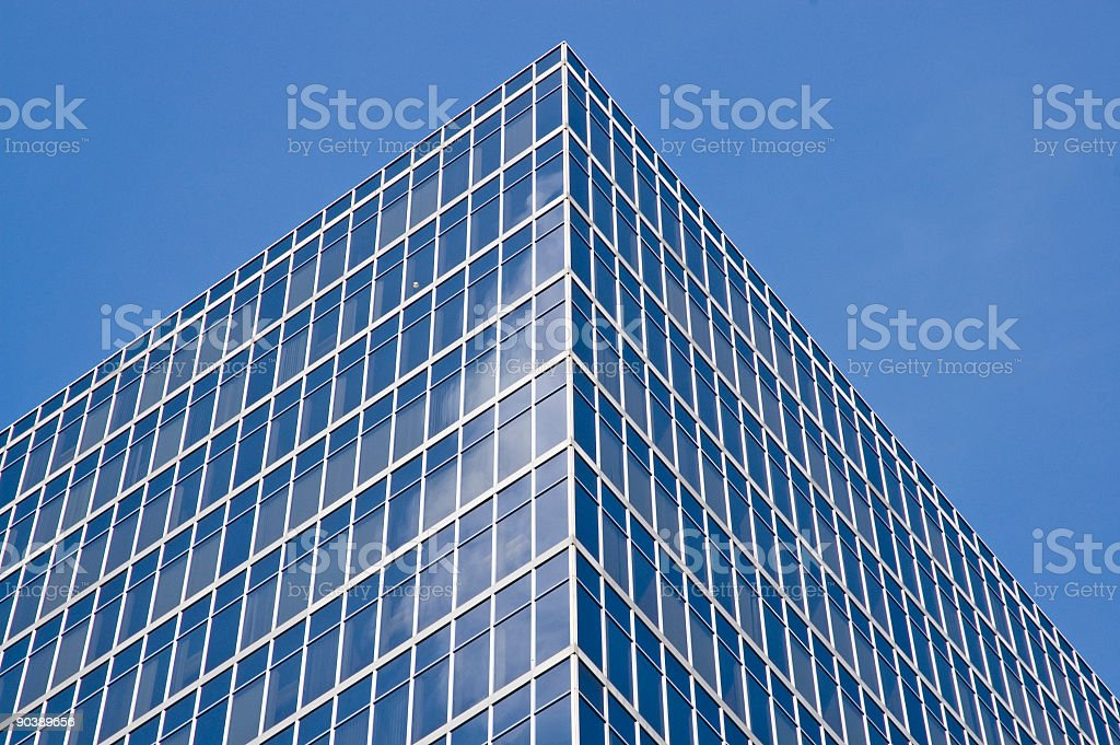 Angled view of a blue modernist office building from below royalty-free stock photo