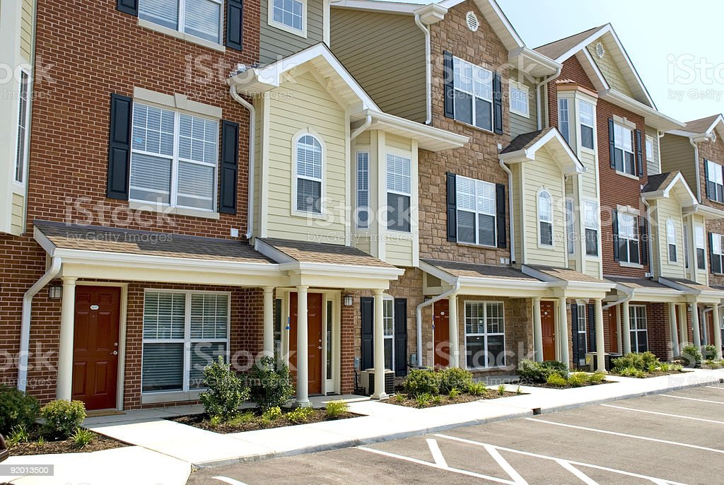 Angled view of a row of new red brick townhouses royalty-free stock photo