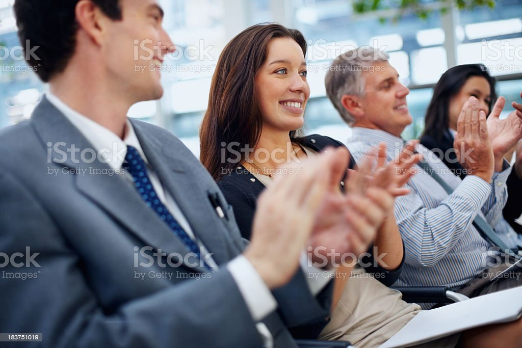 Angled view of business team clapping royalty-free stock photo