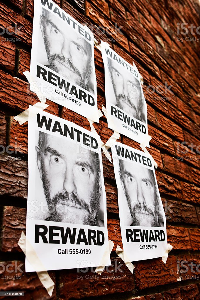 Angled view of four identical 'Wanted' posters royalty-free stock photo