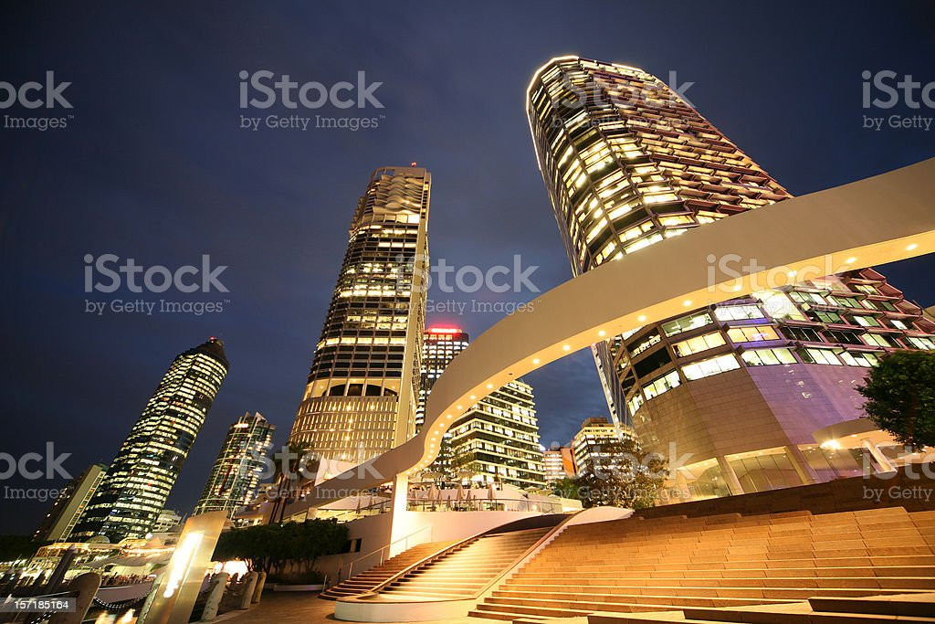 Angled view of large buildings lit up at night stock photo