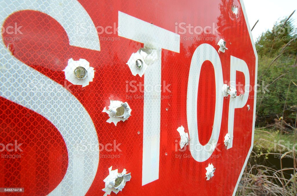 Angled view of 'STOP' sign shot several times from behind stock photo