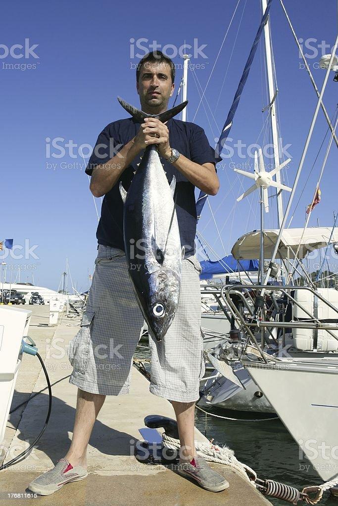 Angler fishing big game Albacore tuna on Mediterranean royalty-free stock photo