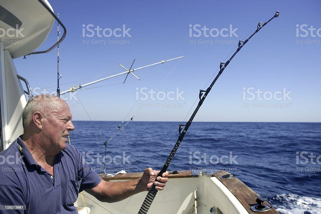 Angler senior big game sport fishing boat royalty-free stock photo