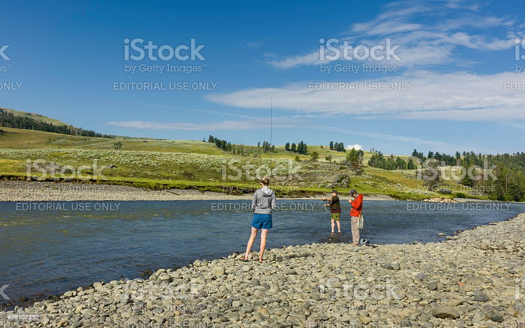 Anglers fish along the Yellowstone River, Wyoming, USA. stock photo