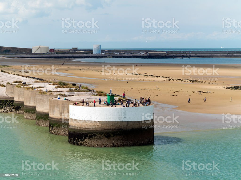 Anglers on quay, Dunkerque, France stock photo
