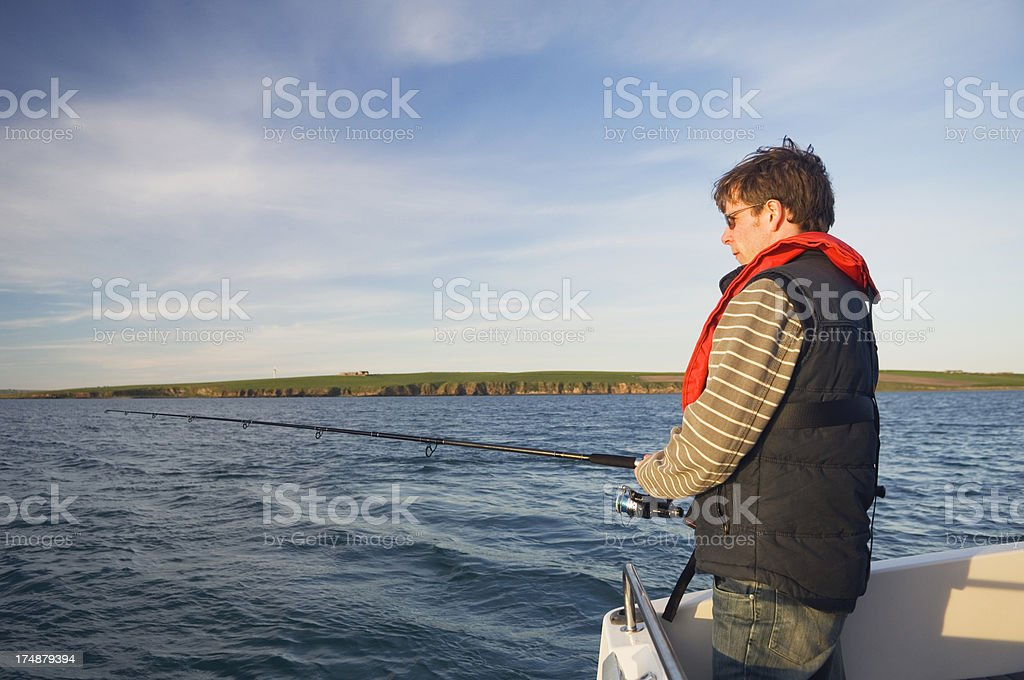 Angling from a boat royalty-free stock photo