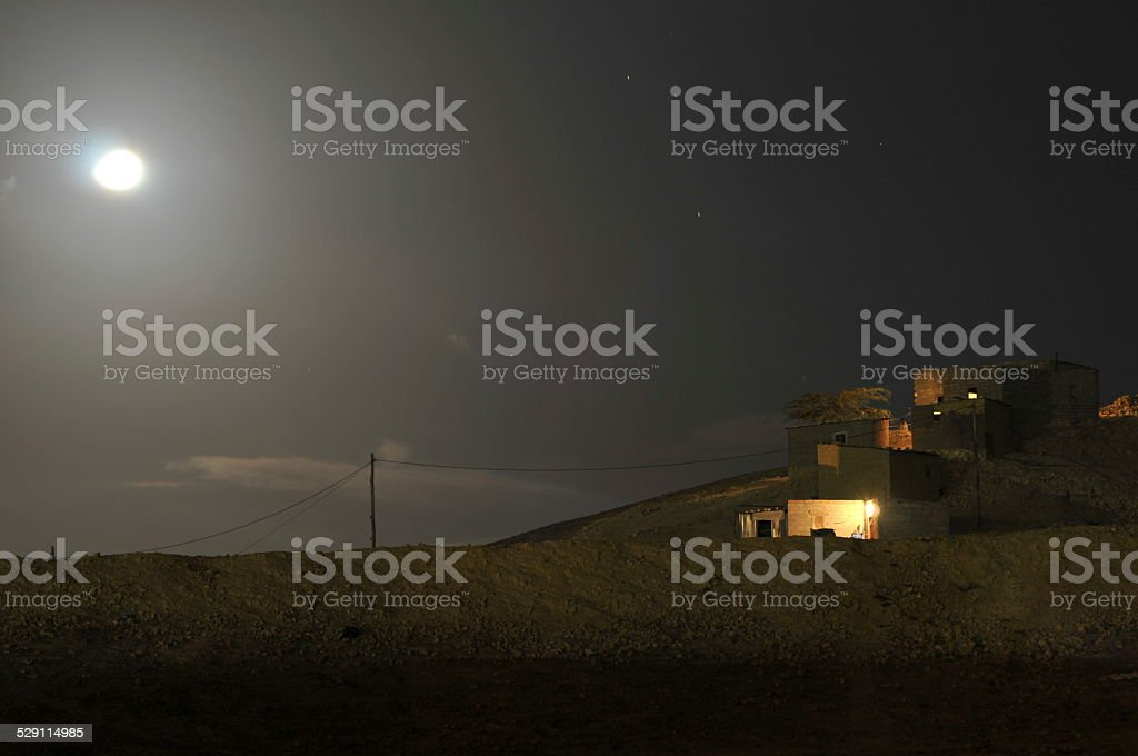 Angolan rural home made of brick by night royalty-free stock photo
