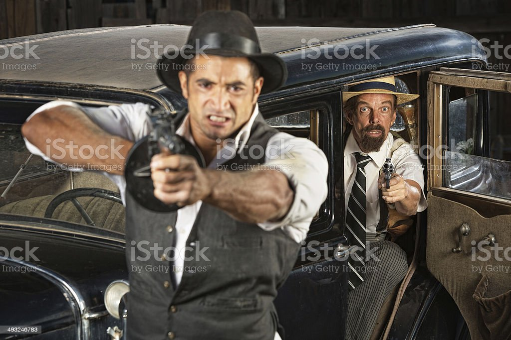 Angry 1920s Era Gangsters with Guns stock photo
