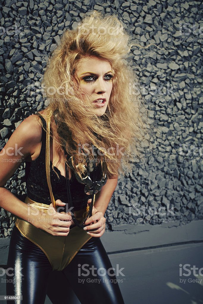 Angry 80's Blonde Woman in Unitard and Leather royalty-free stock photo