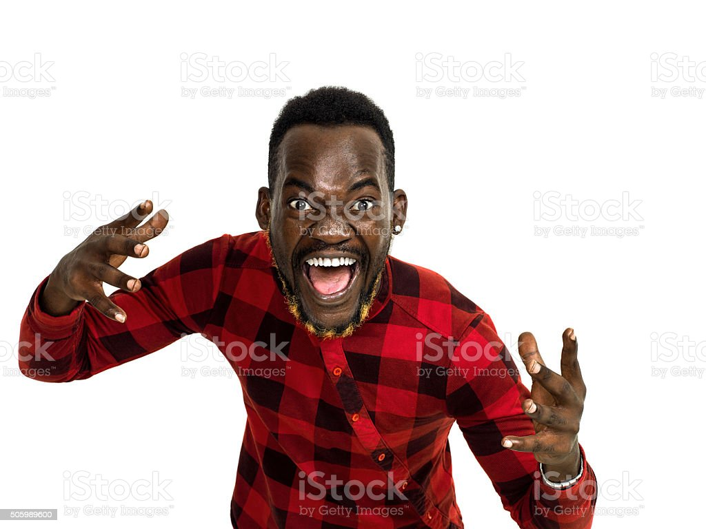 Angry african man portrait wearing red checkered shirt stock photo