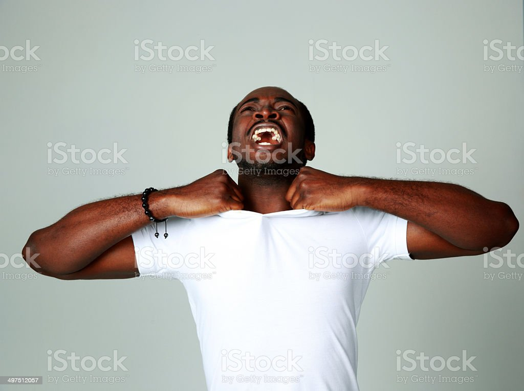Angry african man screaming royalty-free stock photo