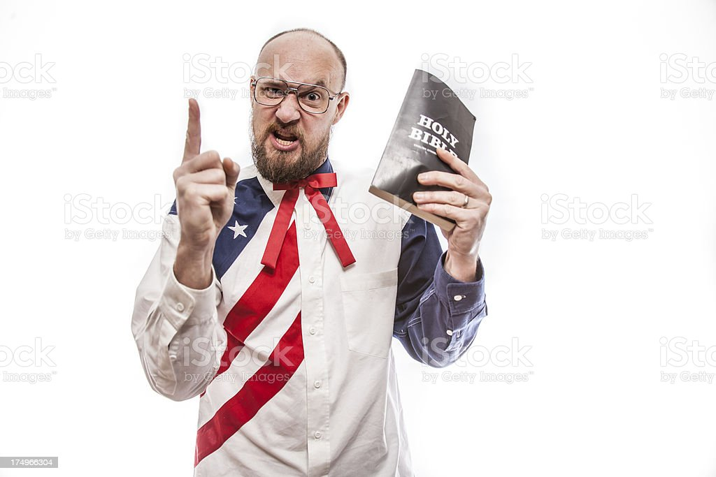 Angry American Preacher with Holy Bible royalty-free stock photo