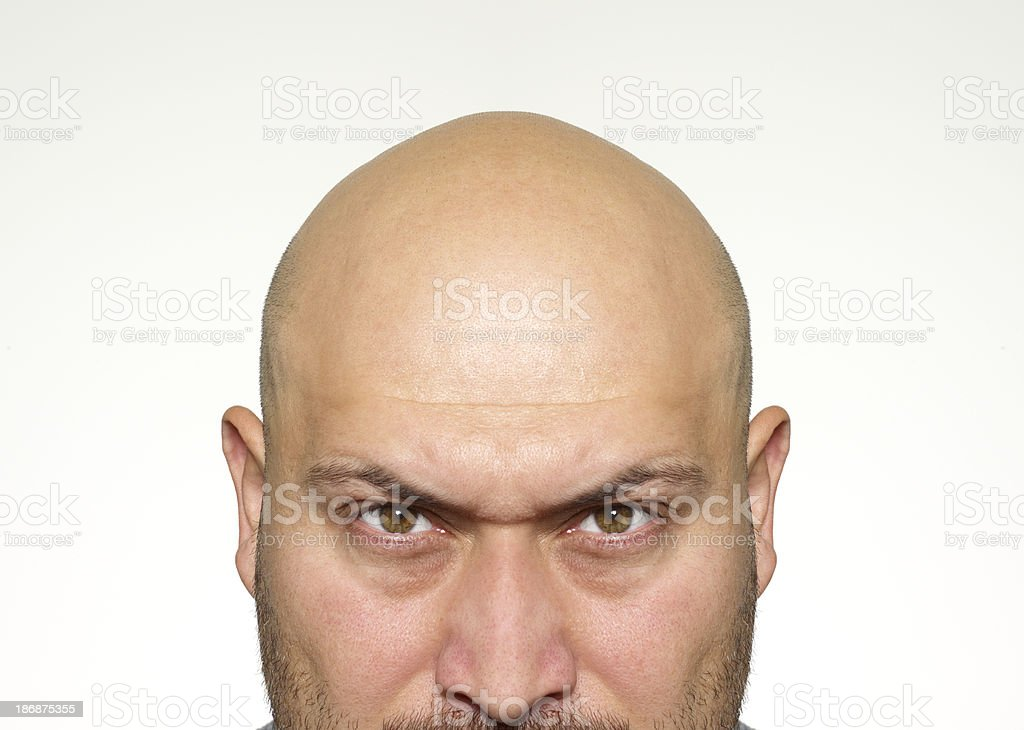 Angry bald man stock photo