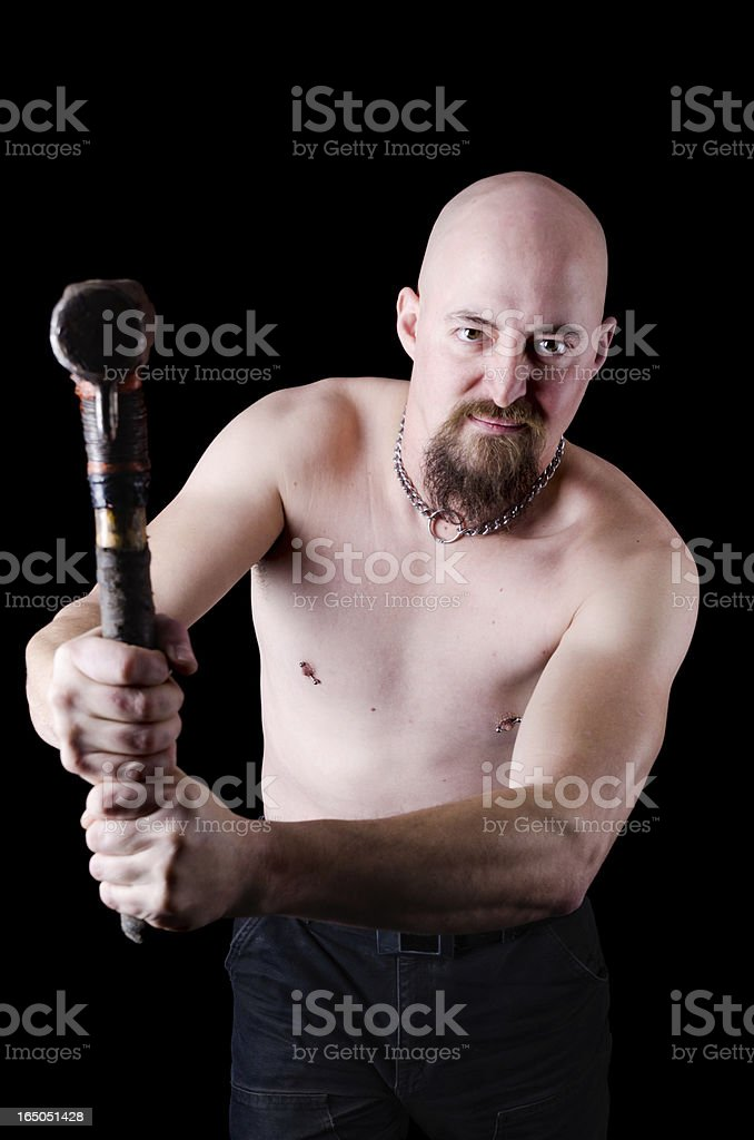 Angry bald man swinging hammer. royalty-free stock photo