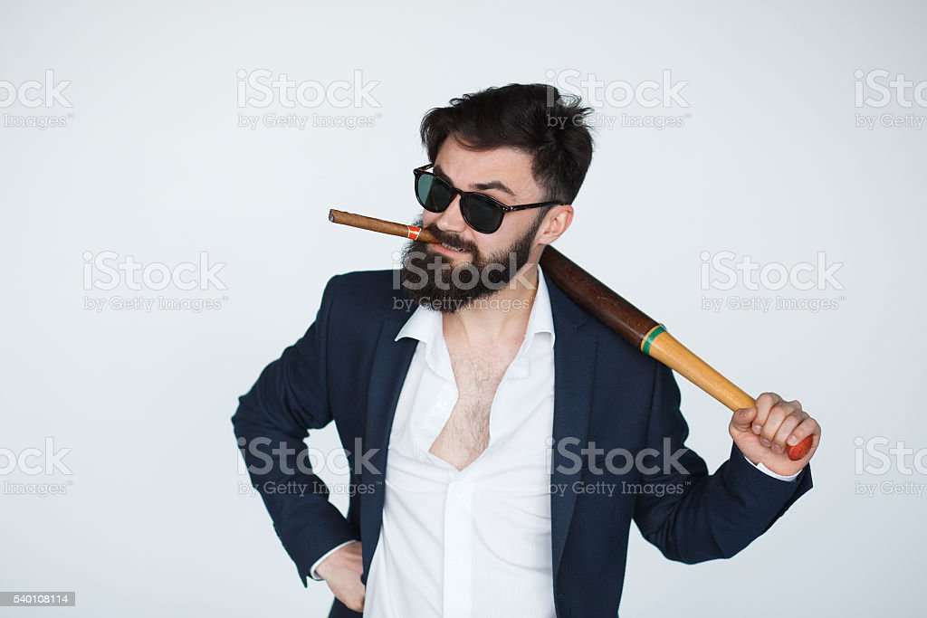 Angry bearded man in black suit and sunglasses stock photo