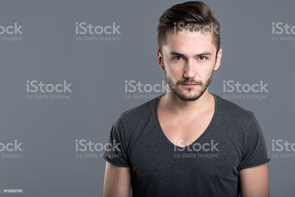 Angry bearded young man stock photo