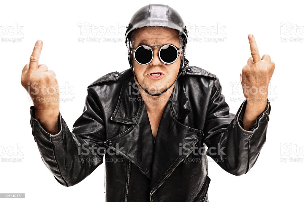 Angry biker showing middle finger with both hands stock photo