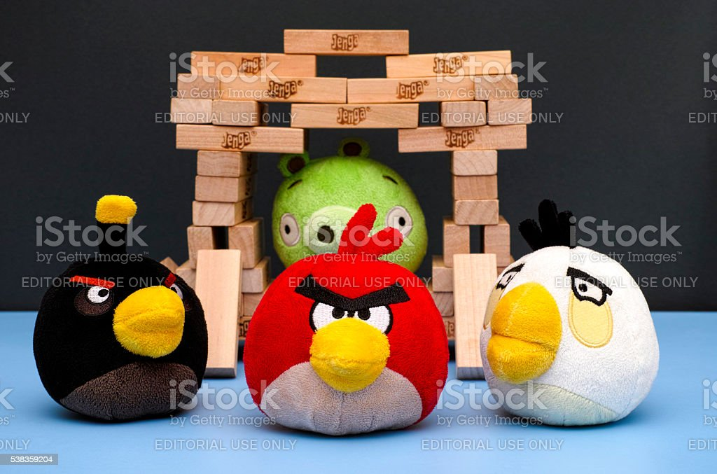 Angry Birds and Bad Piggy in Jenga house stock photo