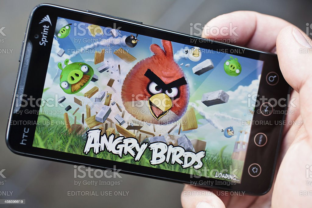 Angry Birds on Sprint HTC EVO phone held in hand stock photo