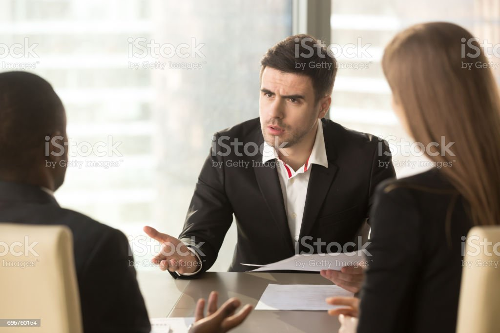 Angry boss dissatisfied with bad result, partners arguing about contract stock photo
