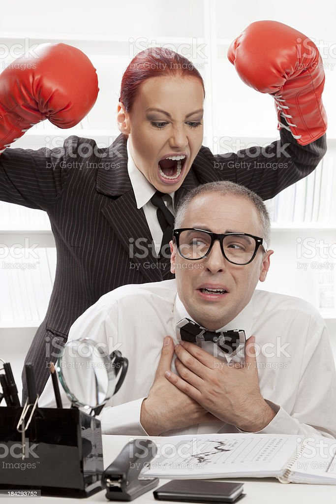 Angry boss harassing her nerdy worker royalty-free stock photo