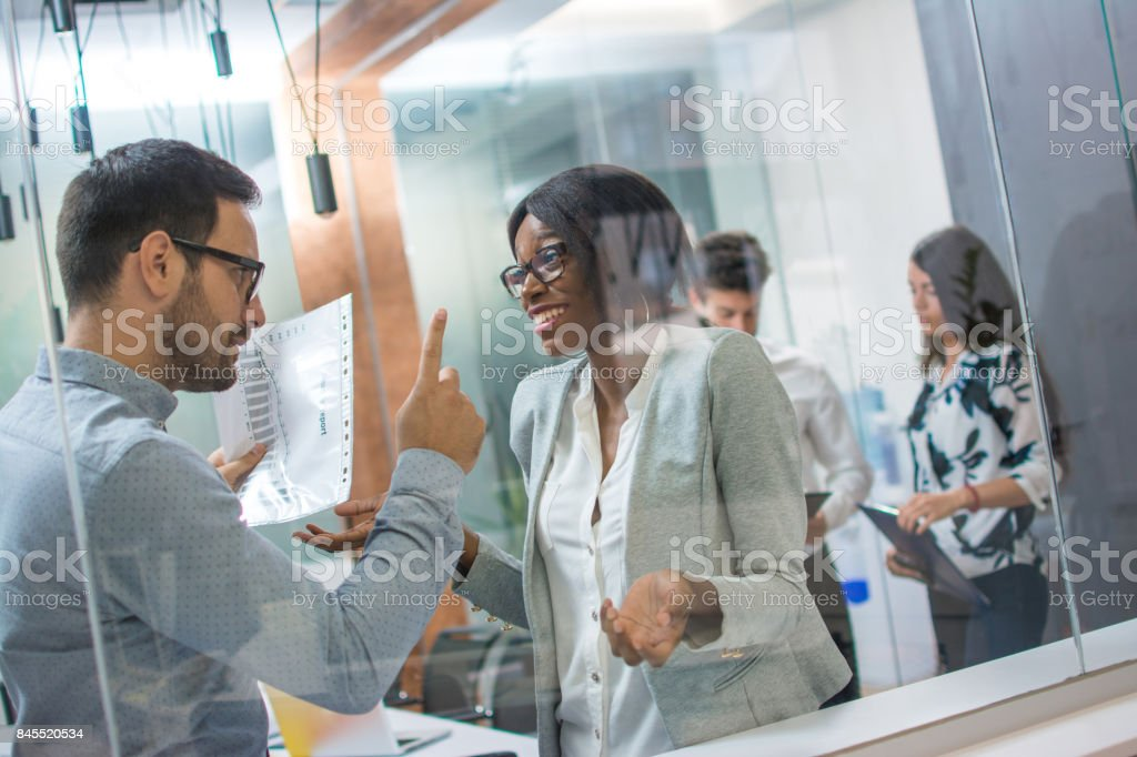 Angry boss with upset face pointing his finger up to female employee making a mistake in business project. Angry boss, frustrated, upset, mistake, fired job concept. stock photo