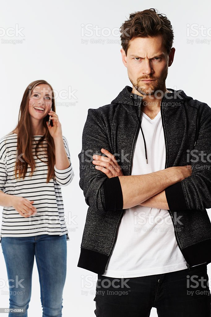Angry boyfriend ignored by girlfriend, portrait stock photo