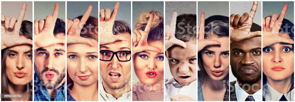 angry bully people men and women giving loser sign stock photo