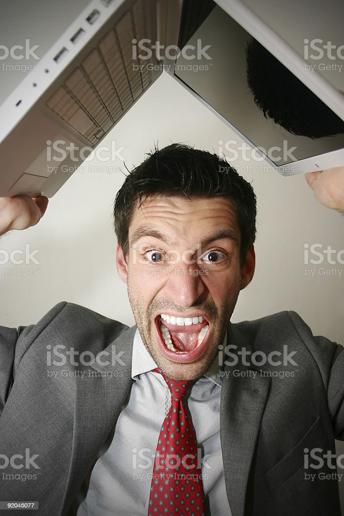 angry business man with laptop royalty-free stock photo