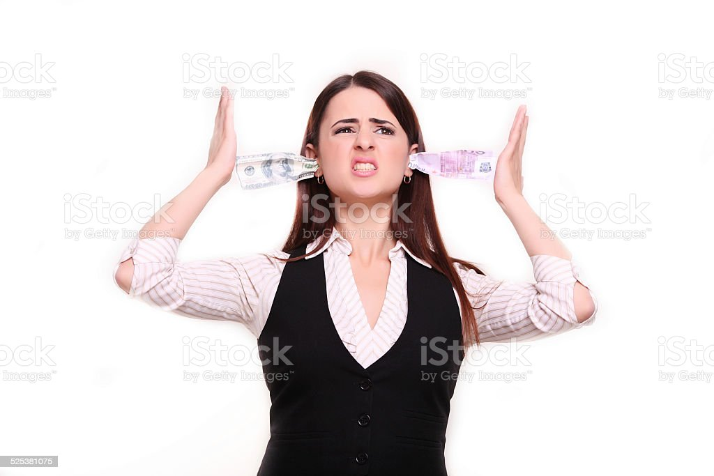 Angry business woman holding money in the ears stock photo