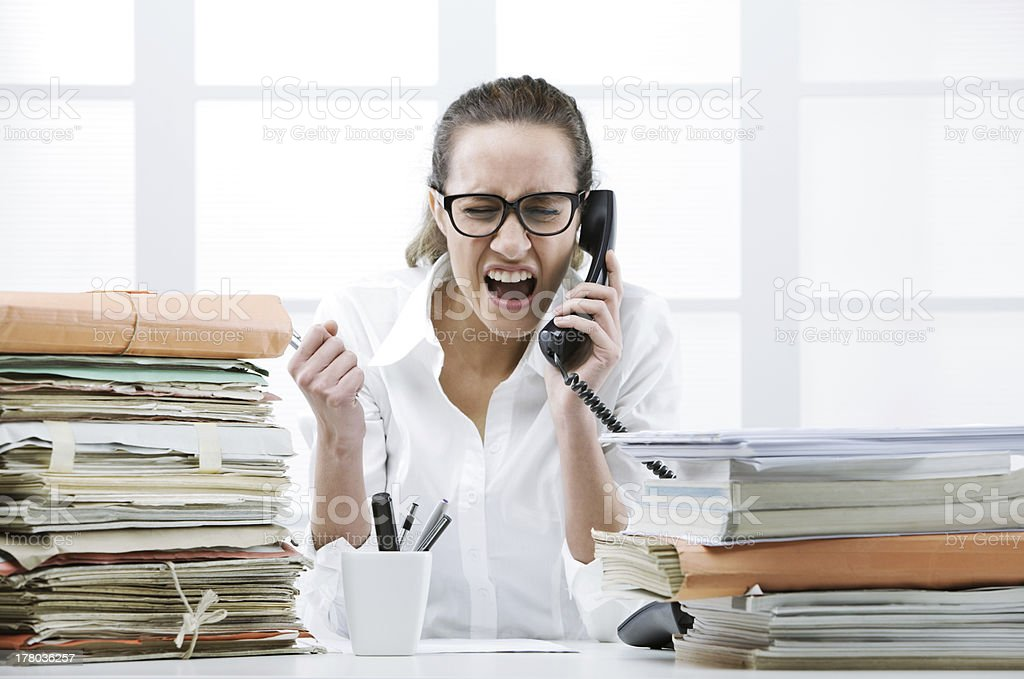 Angry Business woman Shouting At Phone stock photo