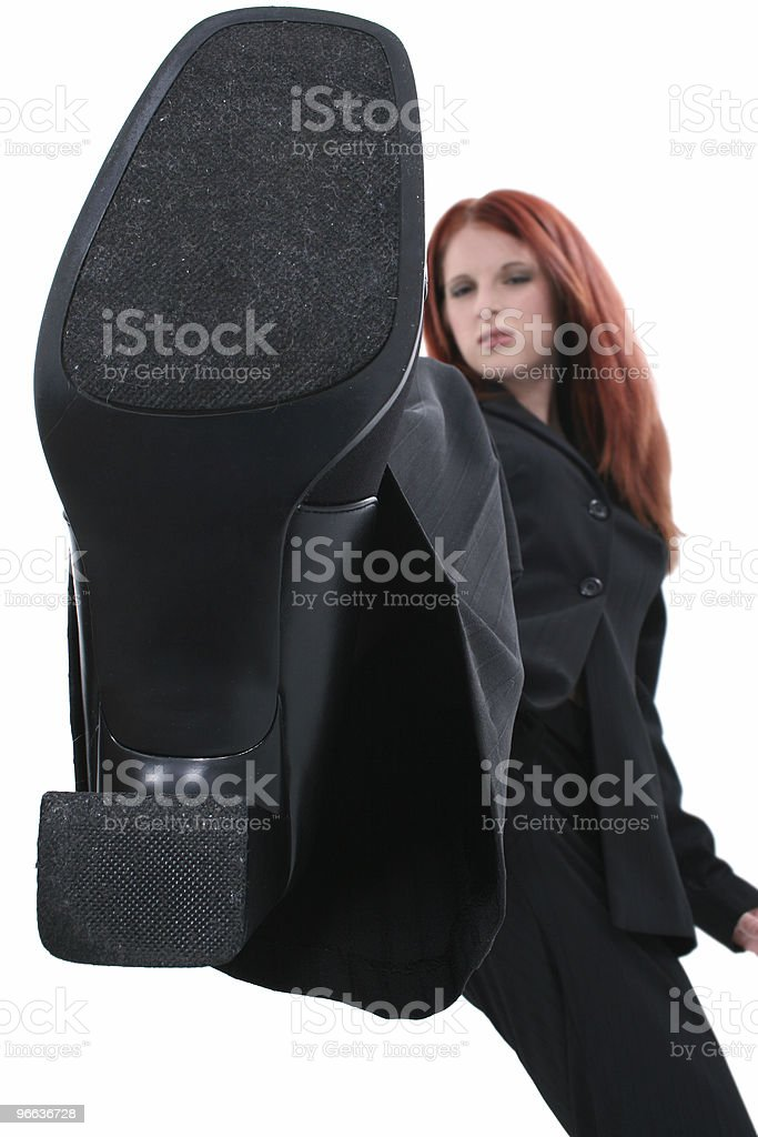 Angry Business Woman Stomping Out The Competition royalty-free stock photo