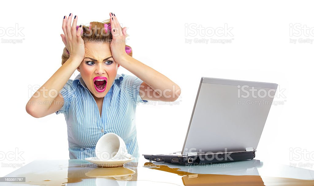Angry business woman with chaos on workspace. Dirty desktop royalty-free stock photo