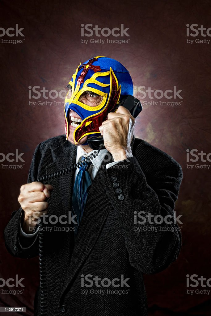 Angry businessman arguing on phone stock photo