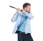 Angry businessman fighting with baseball bat