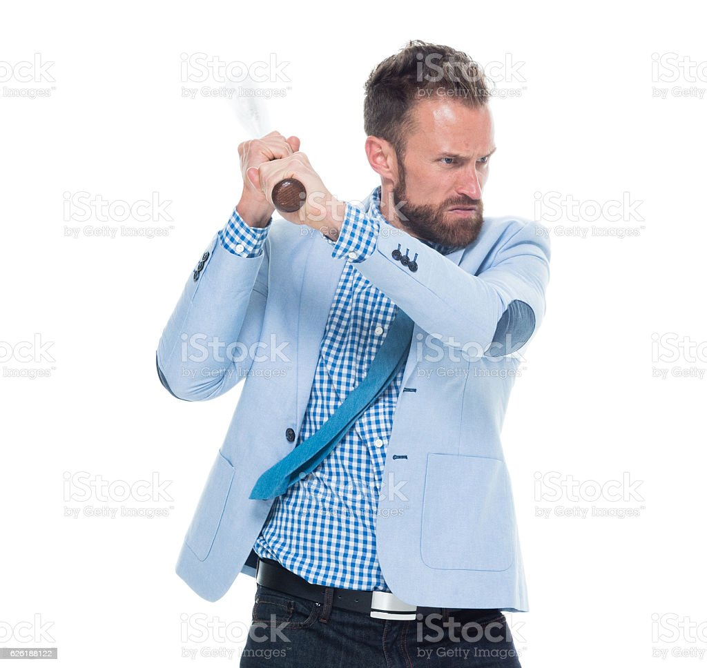 Angry businessman fighting with baseball stock photo
