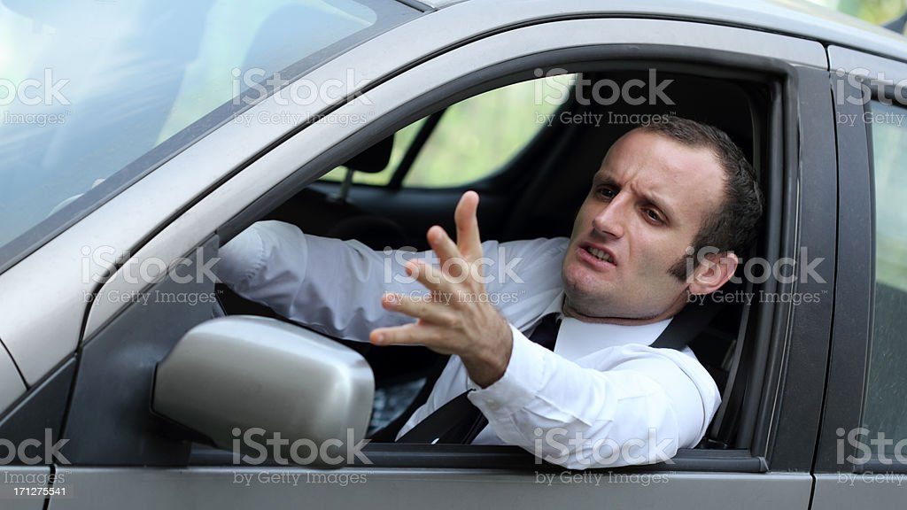 Angry businessman in his car royalty-free stock photo