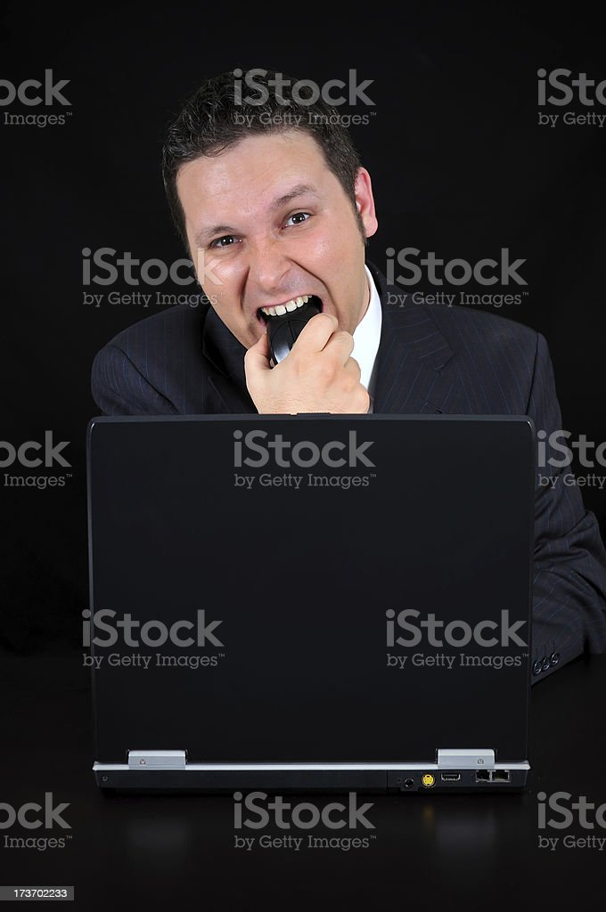 angry businessman is biting the mouse royalty-free stock photo