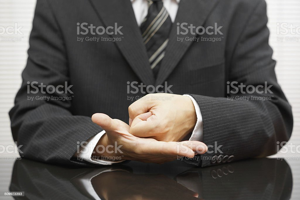 angry businessman   making a fist on meeting stock photo