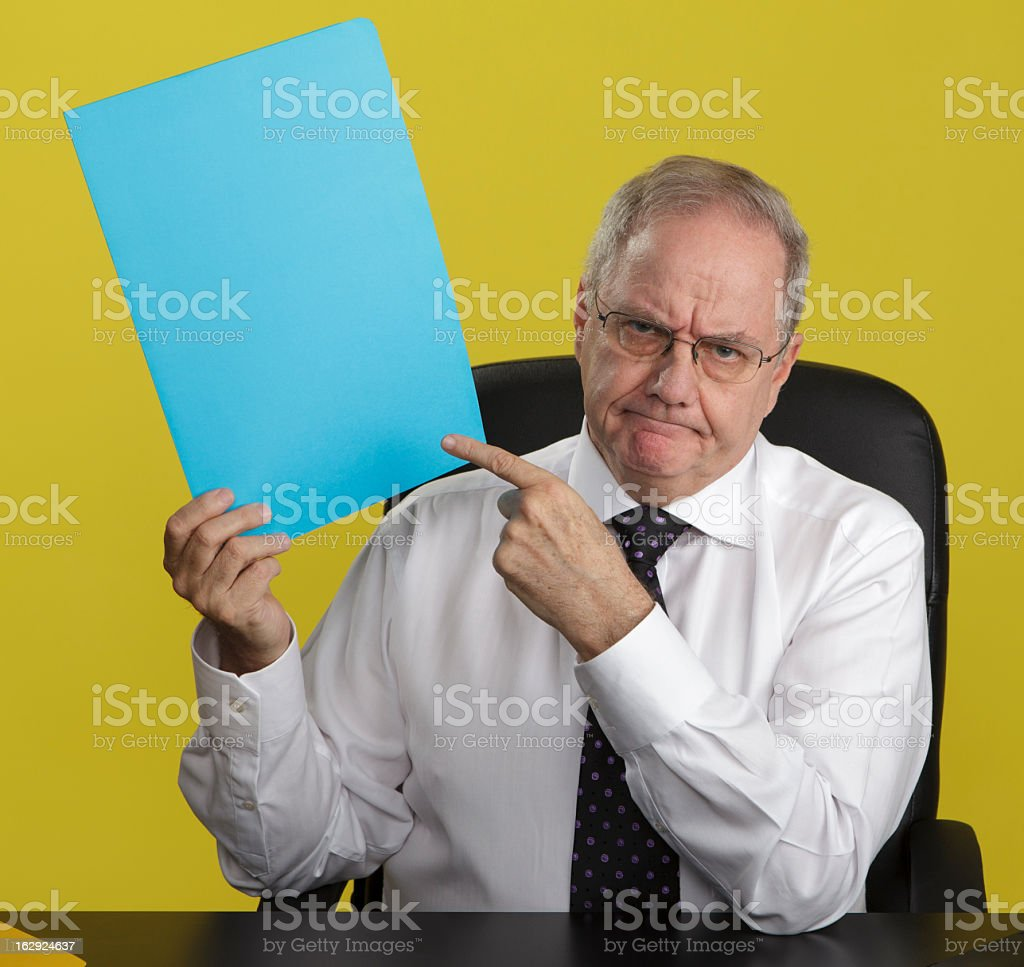 Angry Businessman Pointing at Blank Sign royalty-free stock photo
