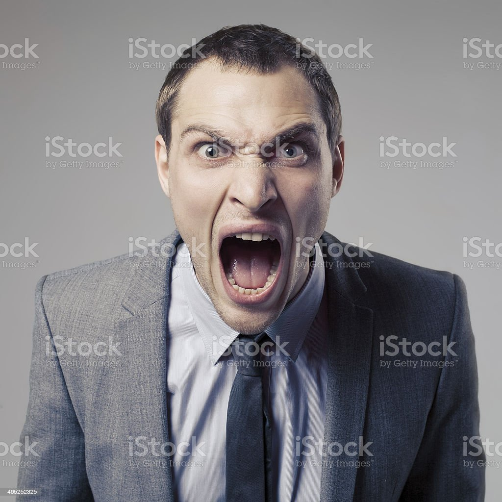 Angry Businessman Screaming stock photo