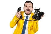 angry businessman screaming to the phone, funny facial expressio