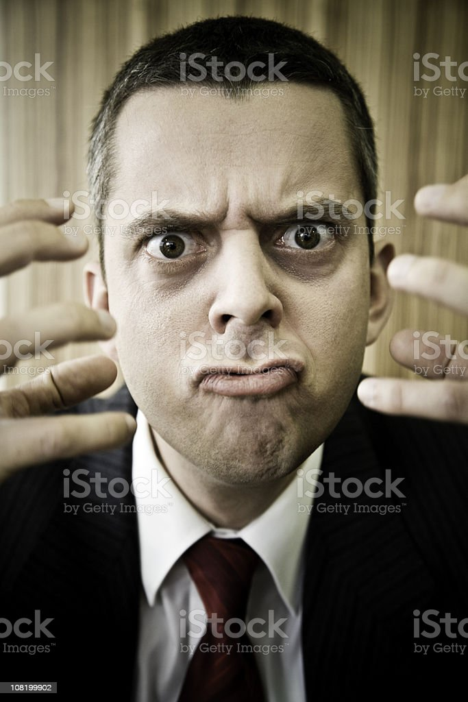 Angry Businessman Shaking Hands in Air royalty-free stock photo