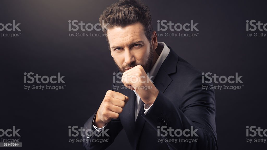 Angry businessman showing fists stock photo