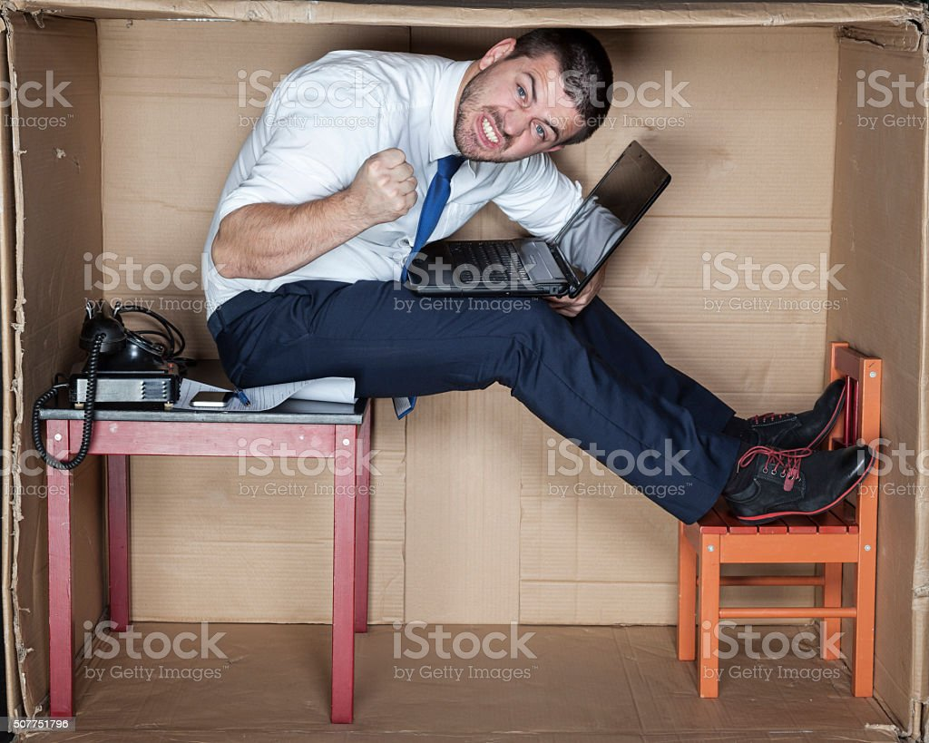 angry businessman sitting on the table stock photo